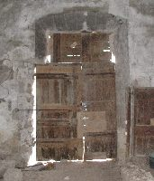 Before: Old window in the Great Hall of the Château de St-Ferriol, converted into a door, probably arounf 1900